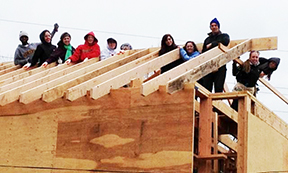 Adelphi student work with Habitat For Humanity