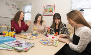 Susan Lederer, Ph.D., mentors student-clinicians (from left to right) Amanda Castellano, Rachel Fernandes and Rebecca Nuzzi in a classroom at Hy Weinberg Center.