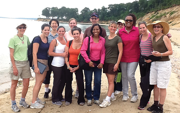 As part of a Race to the Top grant-funded program, Emily Kang, Ph.D., (third from left) and Mary Jean McCarthy (left) led second-grade teachers from Freeport, New York, on an immersive science field trip to Long Island's Caumsett State Historic Park Preserve.