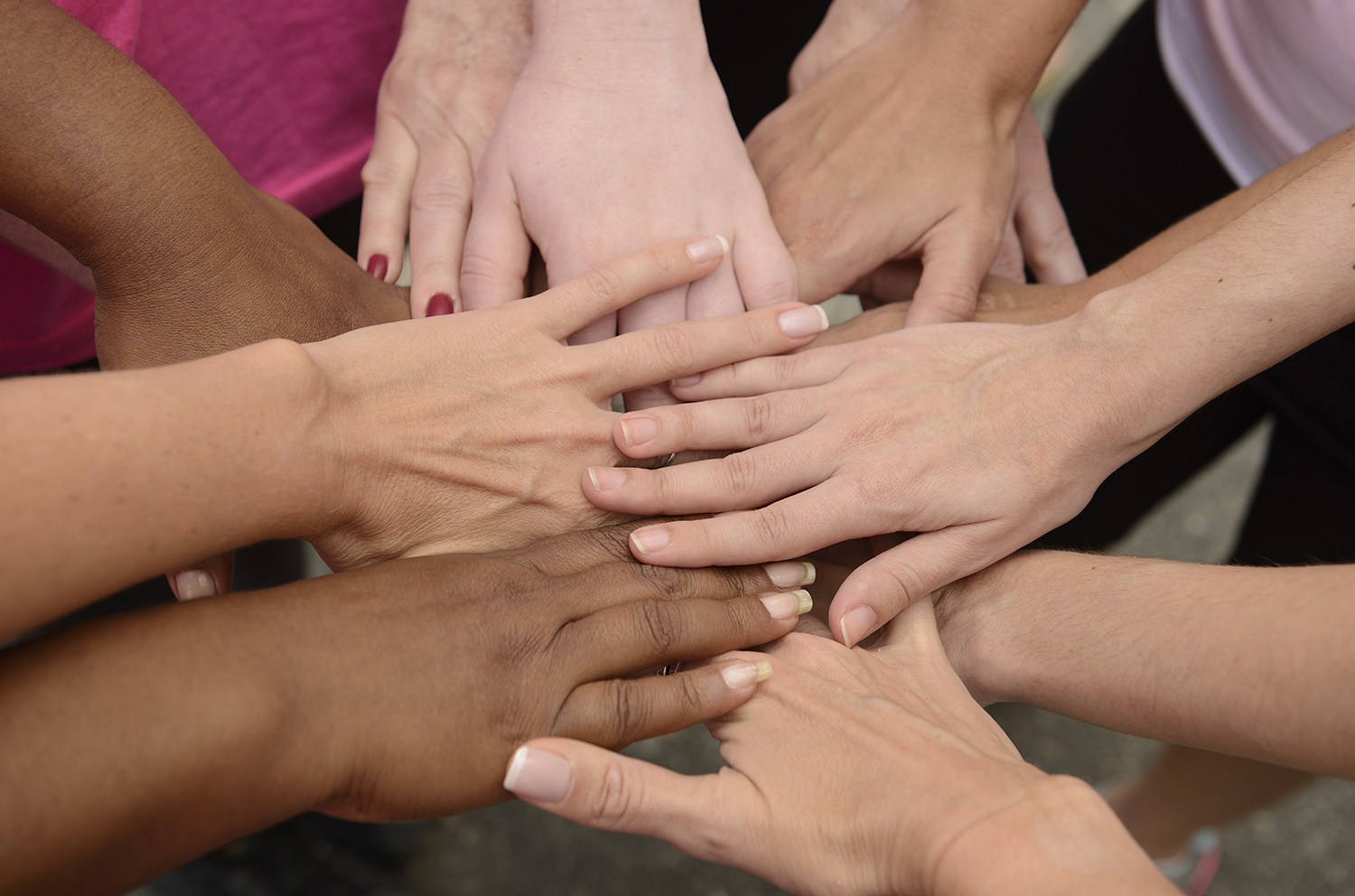 group putting hands together