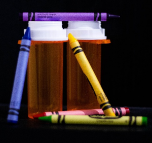 pill bottles and crayons